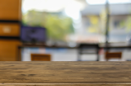 Selected focus empty brown wooden table and Coffee shop blur background with bokeh image, for product display montage Stok Fotoğraf