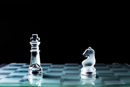 two faced: Knight and knight face to face or confrontation of chess game board