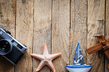 vacation  summer: Travel and vacation items on wooden table. Top view with copy space. Stock Photo