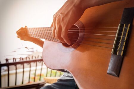 masters of rock: boys hand with a guitar. Stock Photo
