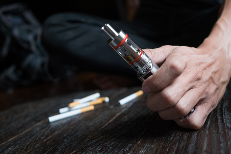 Close-up Of Person Hand Holding Electronic Cigarette.