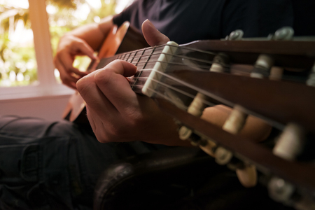 masters of rock: Acoustic guitar guitarist playing. Musical instrument with performer hands.
