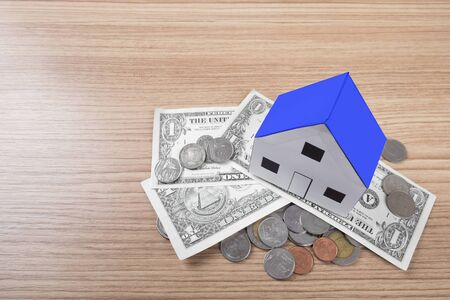 home ownership: holding house representing home ownership and the Real Estate business.