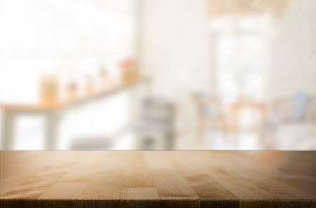 customer focus: Selected focus empty brown wooden table and space of Coffee shop blur background with bokeh image, for product display montage