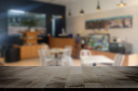 restuarant: Selected focus empty brown wooden table and Coffee shop or restuarant blur background with bokeh image. for your photomontage or product display.