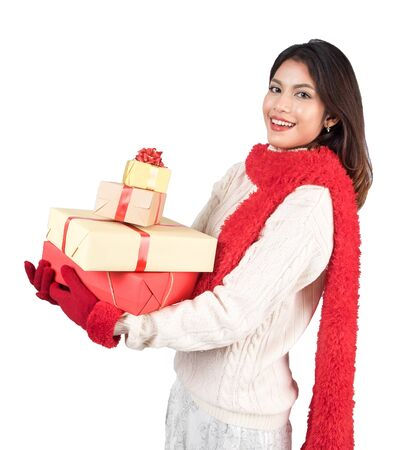 christmas spending: Santa Christmas woman holding christmas gifts smiling happy and excited. Cute beautiful multi-racial Caucasian Asian santa girl isolated on white background with  clipping path Stock Photo