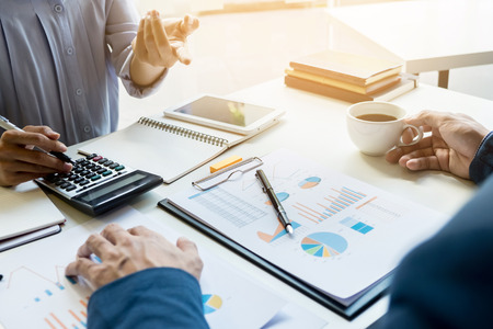 business man financial inspector and secretary making report, calculating or checking balance. Internal Revenue Service inspector checking document. Audit concept Stok Fotoğraf - 70954989