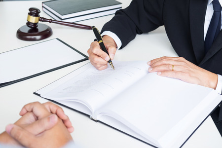 business people and lawyers discussing contract papers sitting at the table. Concepts of law, advice, legal services. Imagens
