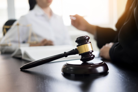 Judge gavel with lawyers advice legal at law firm in background. Concepts of law, services. Reklamní fotografie - 87018925