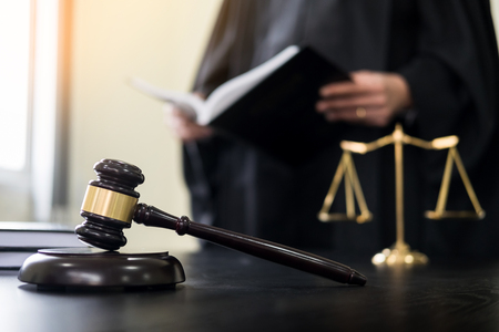 judicial proceeding: gavel and soundblock of justice law and lawyer working on wooden desk background