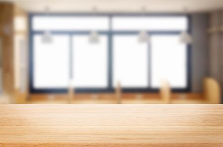 木製テーブルの朝バック グラウンドで窓からすのぼかしの上の空。フォト モンタージュや製品の表示