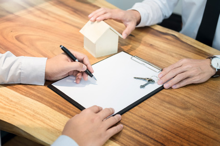 customer signing contract, agreed terms and approved application and analyzing valuation home loan, meeting with bank worker or real estate agent