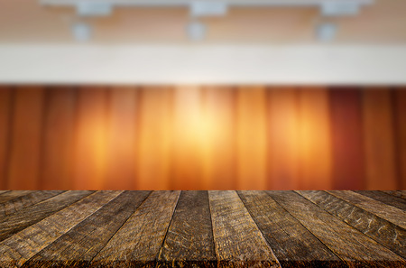 Empty wood table and blurred booked cafe light background. product display template. Business presentation. Stock Photo