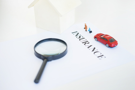 estate: house insurance concept choosing by Magnifying Glass, search for protection. Stock Photo