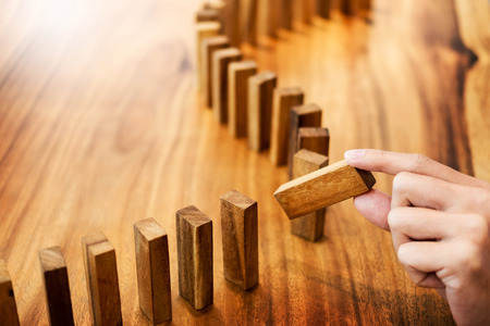 Place a wooden block lines Business man solving a problem. Stock Photo