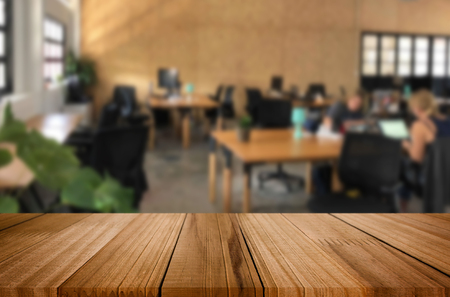 Selected focus empty brown wooden table in office with big windows of the Background with bokeh image. for your photomontage or product display. Stock Photo