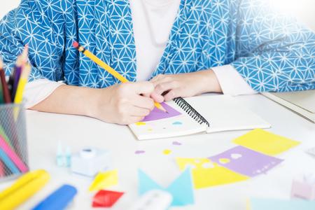 Womans hand cut paper Making a scrap booking or other festive decorations DIY accessories arrangement