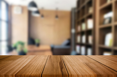 Wooden board empty Table Top And Blur Interior over blur in coffee shop Background, Mock up for display of product. 版權商用圖片