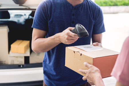 Shipment working delivery service concept, Messenger Leaving Parcel Barcode Scanning checking order to confirm before sending customer Banco de Imagens
