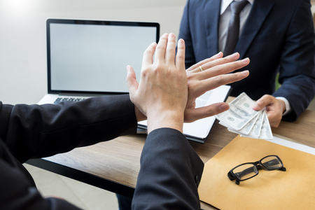 anti bribery and corruption concepts, Businessman refusing or rejecting the money to take bribe from partner Stock Photo