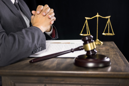 justice and law concept.Male judge in a courtroom working on wood table with documents., attorney court judge justice gavel legal legislation concept Stockfoto