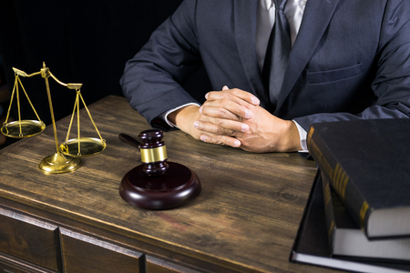 justice and law concept.Male judge in a courtroom working on wood table with documents., attorney court judge justice gavel legal legislation concept Zdjęcie Seryjne