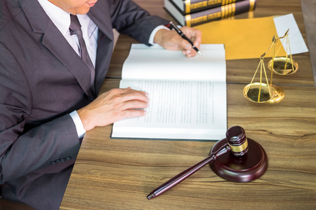 gavel and soundblock of justice law and lawyer working on wooden desk background