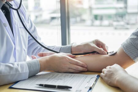 doctor hands checking blood pressure of a patient, Medical care concept Stock Photo