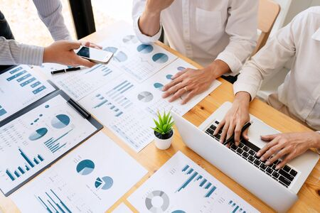 Business People Talking Discussing with coworker planning analyzing financial document data charts and graphs in Meeting and successful teamwork Concept Stockfoto