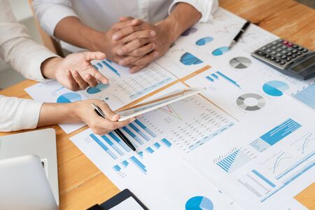 Business People Talking Discussing with coworker planning analyzing financial document data charts and graphs in Meeting and successful teamwork Concept Imagens
