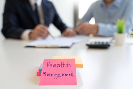 wealth management concept, business man and team analyzing financial statement for planning financial customer case in office