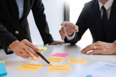 wealth management concept, business man and team analyzing financial statement for planning financial customer case in office Фото со стока