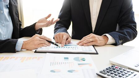 Business People Talking Discussing with coworker planning analyzing financial document data charts and graphs in Meeting and successful teamwork Concept Banco de Imagens