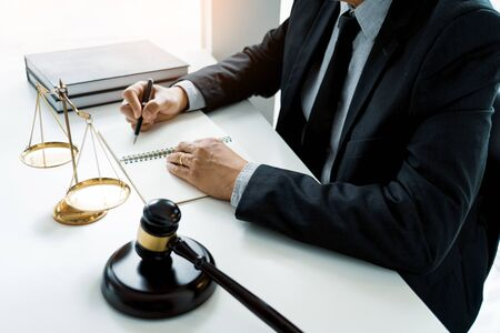 The private office workplace for consultant an young lawyer legislation with gavel and document on wood table