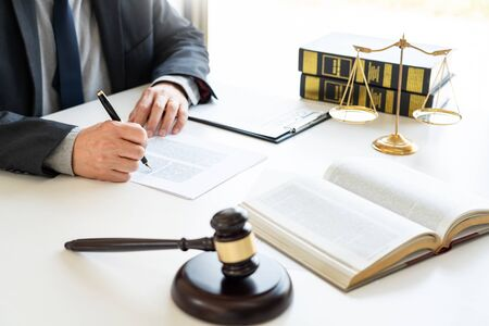 The private office workplace for consultant an young lawyer legislation with gavel and document on wood table, legal justice and judgment concept 写真素材