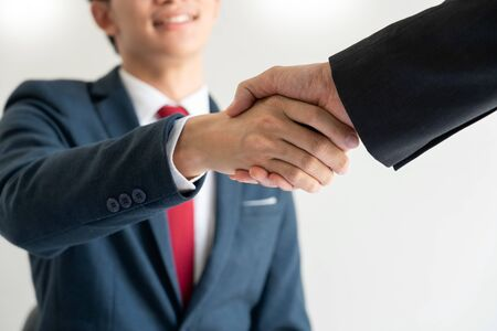 success dealing, two people shake hand as cooperate and teamwork to success in business and financial, greeting and partner concept.