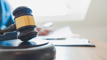lawyer judge reading documents at desk in courtroom. Stock Photo