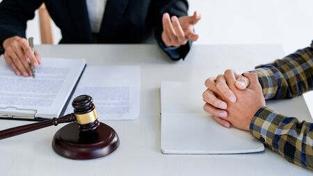 lawyer having meeting and consoling solution to his clients provide legal advice and trust commitment strain serious for problem, justice and attorney concept Reklamní fotografie