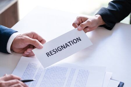 Employee businessman submit or sending resignation document letter to human resource manager or boss, Change of job, unemployment, resign concept