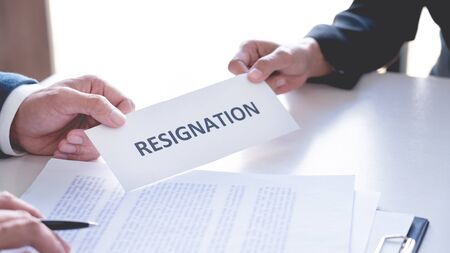 Businessman sending resignation letter to the executive employer boss on desk in order to resign dismiss contract, job placement and vacancies concept