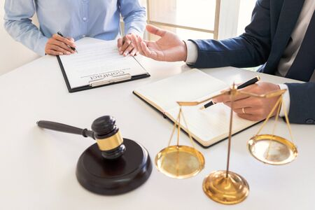 Male lawyer or judge consult with client check contract papers recommend legal proposals, Law services concept. Foto de archivo