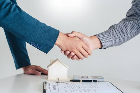 House developers and customer shaking hand after finish buying or rental real estate for transfer right of property.