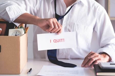 Businessman holding with I quit words card letter, resign employee Change of job concept