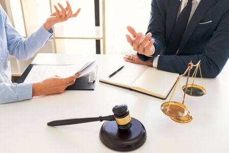 Male lawyer or judge consult with client check contract papers recommend legal proposals, Law services concept.