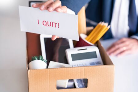 Businessman holding with I quit words card letter, resign employee Change of job concept Фото со стока