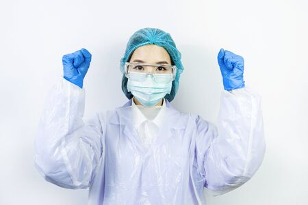 Scientist doctor wearing face mask, glasses or goggles and protective suit to fight coronavirus pandemic Covid-19, coronavirus pandemic threat quarantine, medical and healthcare concept Stock Photo