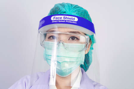Scientist doctor wearing face mask, glasses or goggles and protective suit to fight coronavirus pandemic Covid-19, coronavirus pandemic threat quarantine, medical and healthcare concept