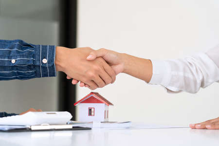 estate agent giving house keys customer sign agreement property for sale, Buying and selling homes concept