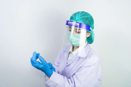 Scientist doctor wearing face mask, glasses or goggles and protective suit to fight coronavirus pandemic Covid-19, coronavirus pandemic threat quarantine, medical and healthcare concept Stok Fotoğraf