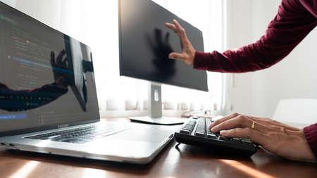 Software developer or programmer working data debugging improvement binary algorithm on desktop pc in a software develop company office